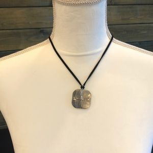 Mother of pearl square on black cord necklace
